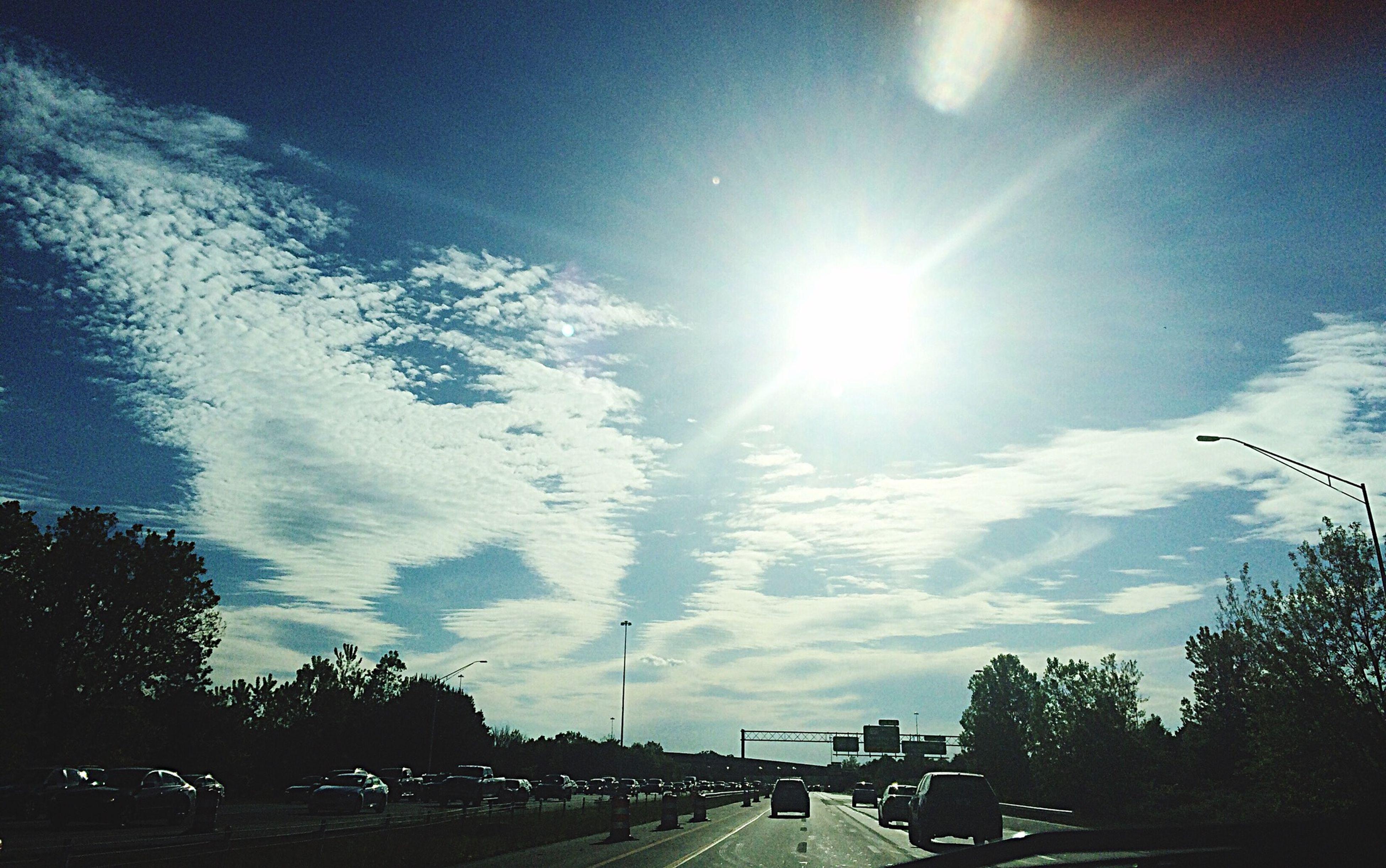 sun, sunbeam, sunlight, sky, transportation, road, lens flare, tree, the way forward, car, cloud - sky, sunny, street, nature, silhouette, built structure, diminishing perspective, vanishing point, blue, bright