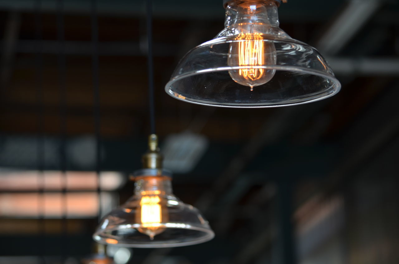 light bulb, electricity, filament, lighting equipment, glass - material, illuminated, bulb, glowing, technology, close-up, no people, focus on foreground, indoors, scientific experiment, innovation