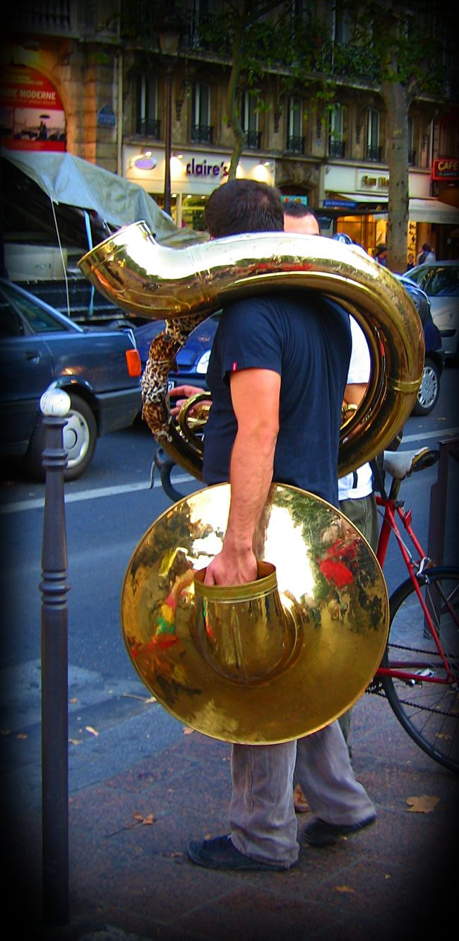 Man wrapped in Sousaphone waits for traffic lights. Brass Instruments City Life Crazy Pedestrian Musician Outdoors Philharmonic  Sousaphone Strange