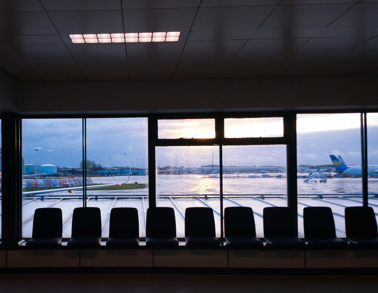 Window Indoors  Looking Through Window Architecture Travel Destinations Cityscape City Day No People Sky Airport Manchester Planes Aircraft Travel Waiting Sunlight Holiday Vacations Destination Airlines