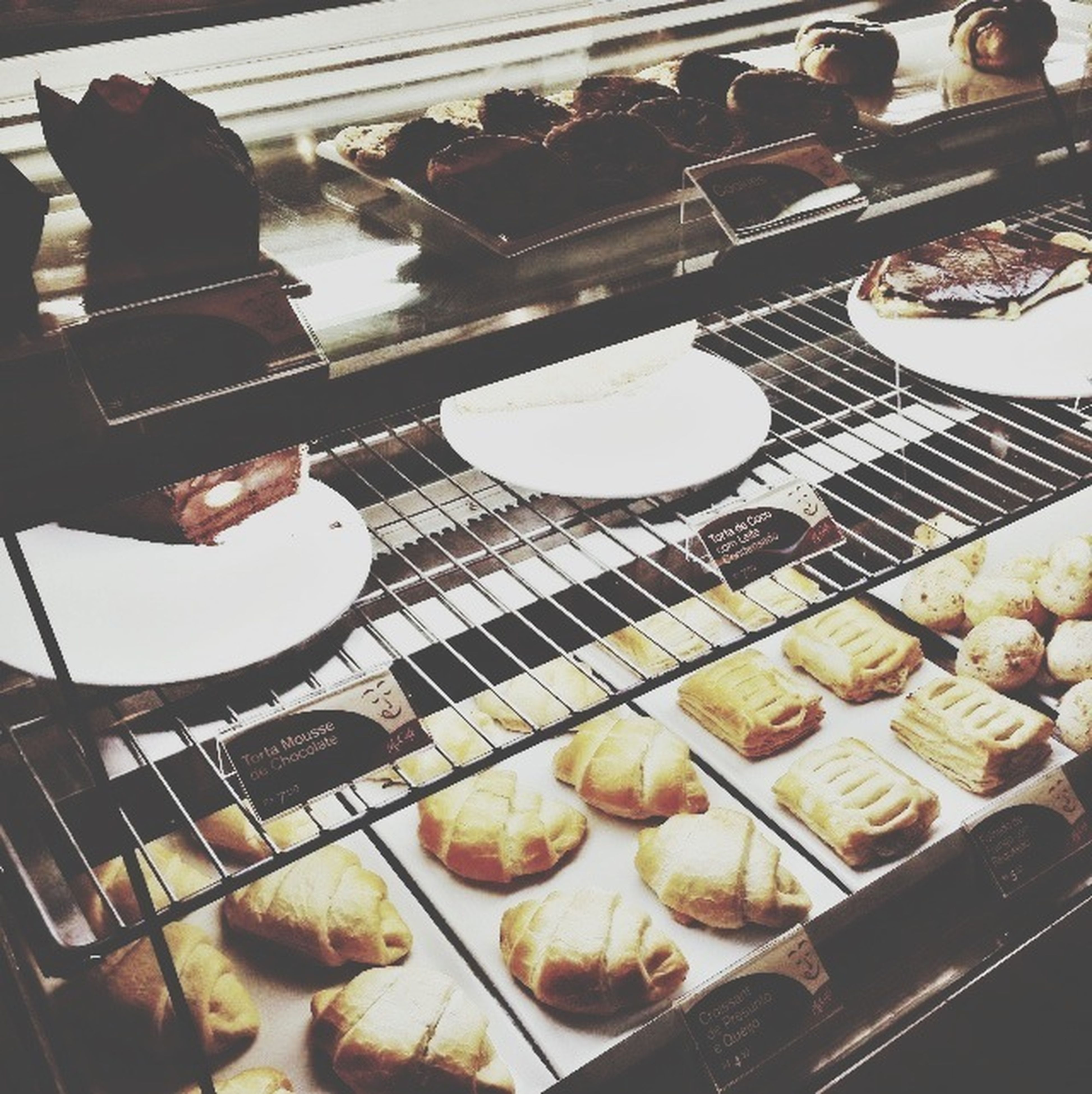 food and drink, indoors, food, freshness, ready-to-eat, still life, table, sweet food, plate, dessert, unhealthy eating, indulgence, high angle view, baked, tray, meal, bread, close-up, temptation, restaurant