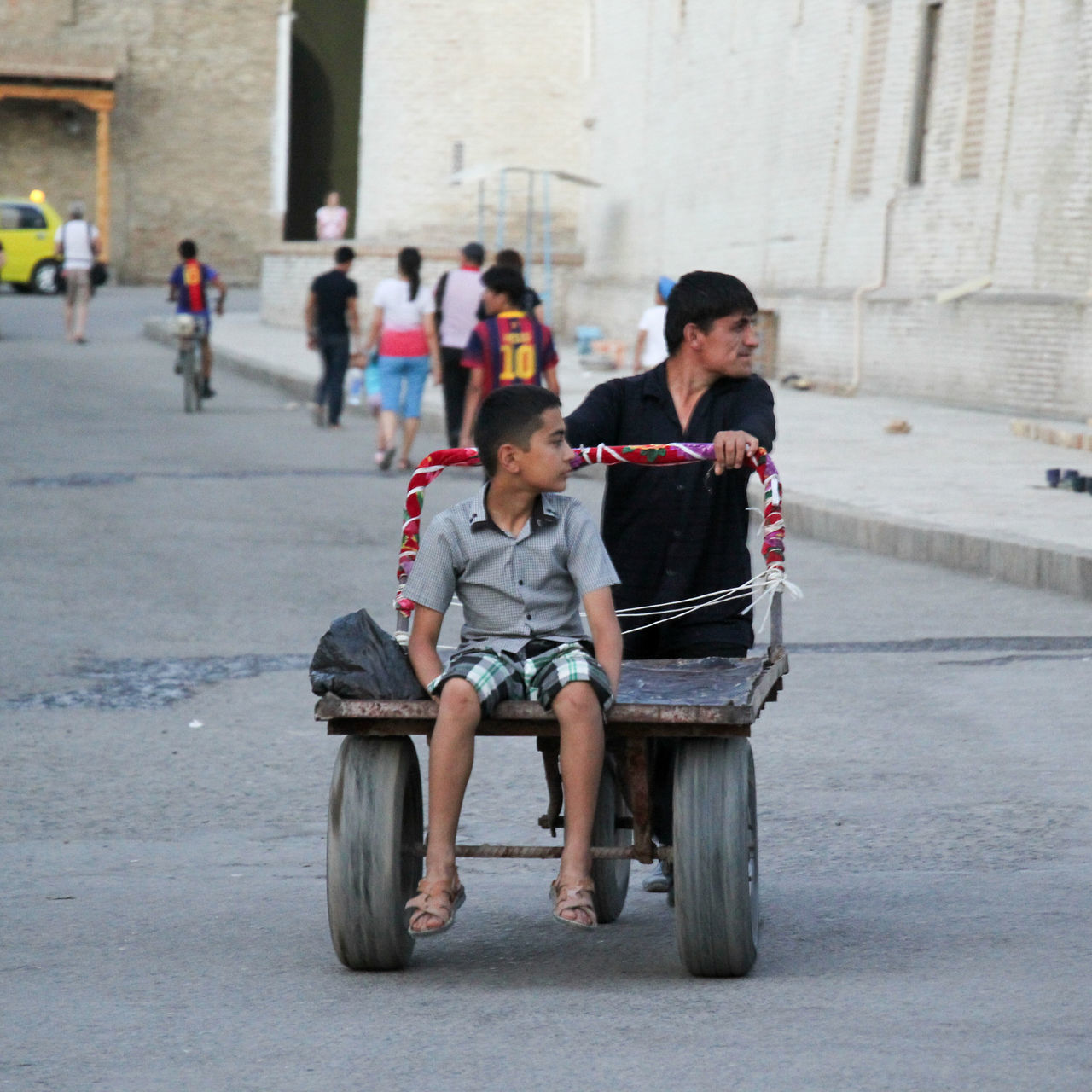 Adult Architecture Building Exterior Built Structure Bukhara Childhood City Day Father & Son Full Length Lifestyles Outdoors People Real People Riding Silk Road Sitting Street Photography Togetherness Transportation Uzbek People Uzbekistan