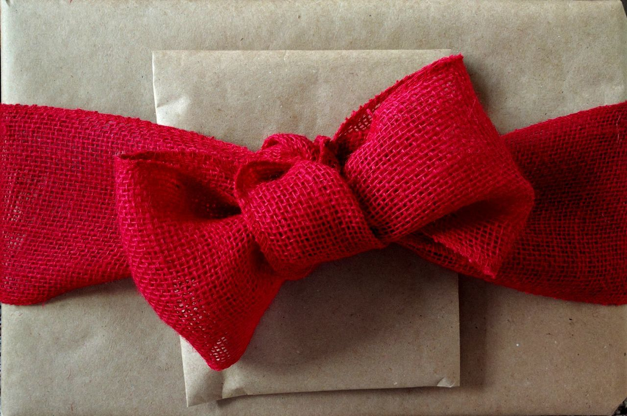 Wrapped Gift Present Gift Bow Red Textile Close-up Tied Bow No People Indoors  Day Burlap Brown Paper Untraditional