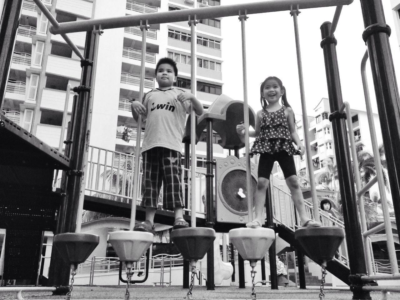 Full Length Of Siblings Playing In Park