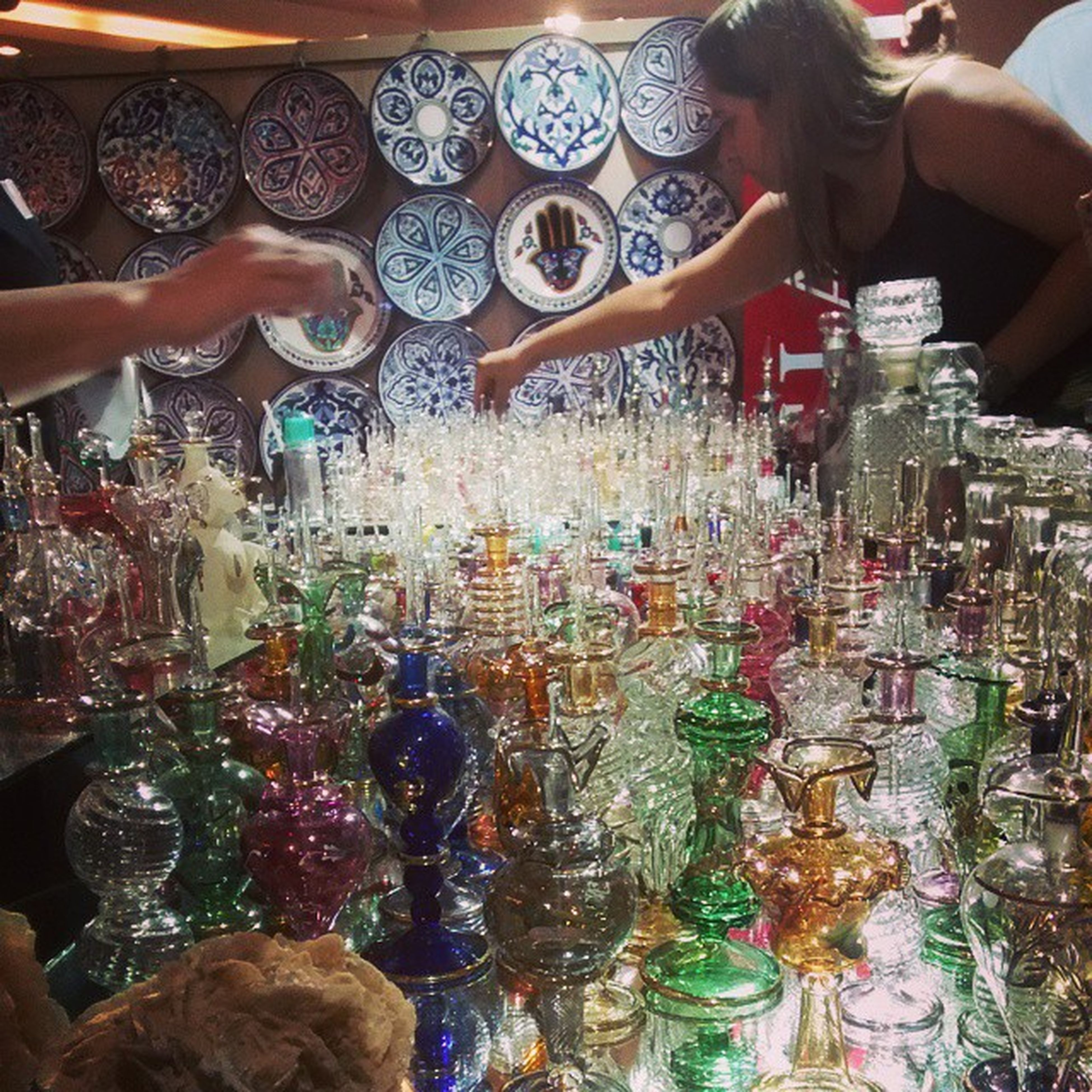 indoors, lifestyles, person, leisure activity, celebration, high angle view, large group of objects, variation, choice, abundance, tradition, cultures, retail, men, for sale, multi colored