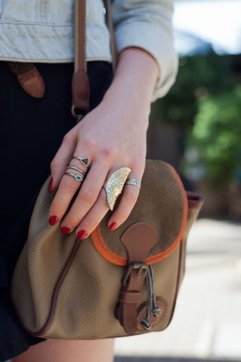 Island Fashion Scene Fashion Mystical Mythical Military Fashion Fair Skin White Skin Red Nails Denim Vintage Personal Style Rings Close-up Day Focus On Foreground Human Hand Lifestyles Men Midsection Nail Polish One Person Outdoors Real People
