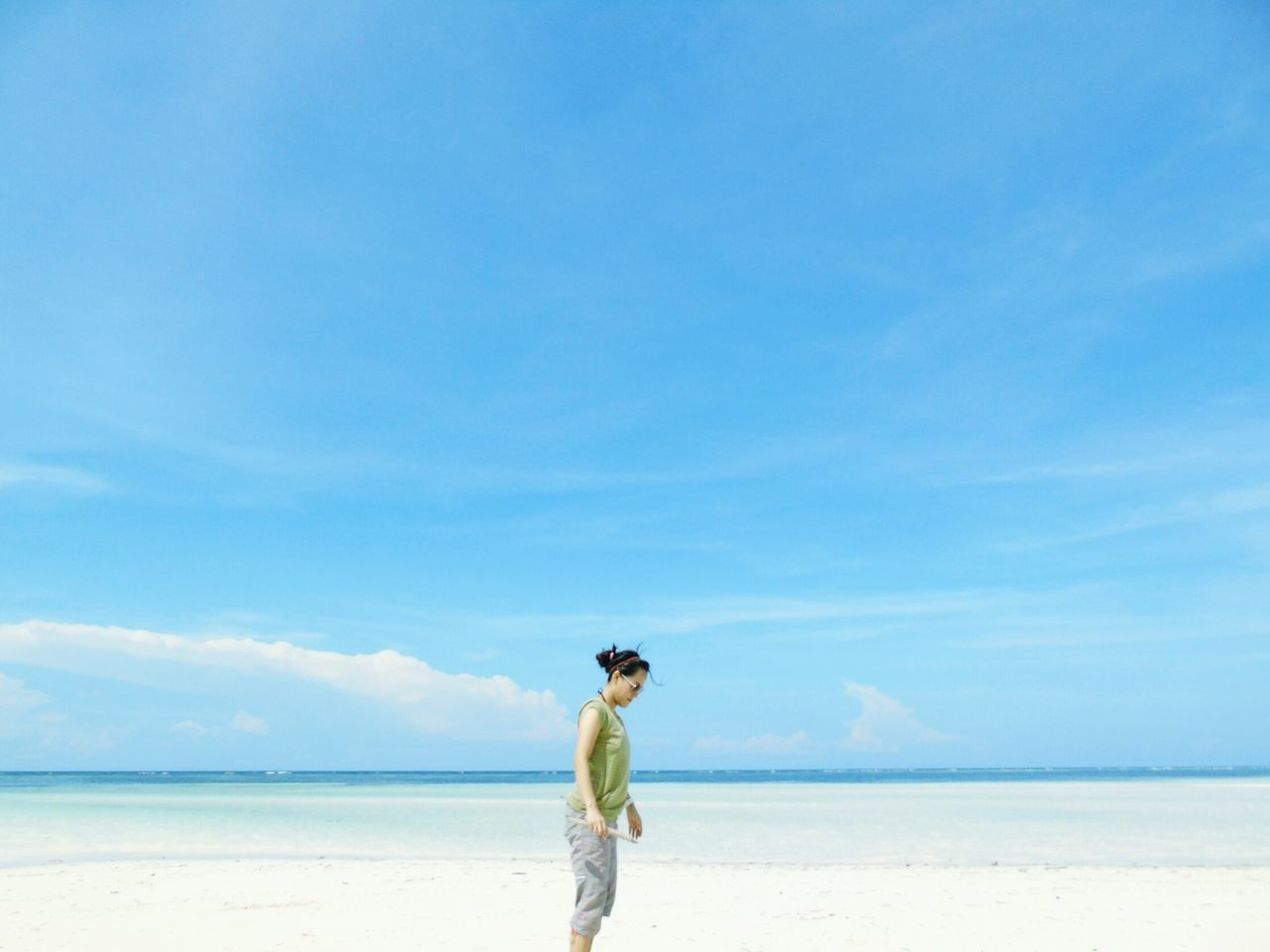 Low tide Sea Beach Water Sky Blue Horizon Over Water One Person Day Full Length Nature One Woman Only Outdoors Leisure Activity Scenics Beauty In Nature Vacations People The Great Outdoors With Adobe Beautiful Summer Travel Destinations Traveling Travel Sumba Timur Village
