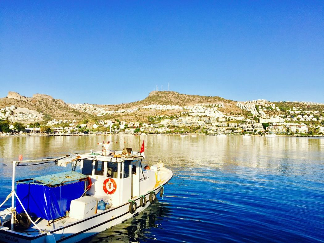 Nautical Vessel Clear Sky Blue Water Moored Mode Of Transport Outdoors Boat Scenics Tranquility Day No People Beauty In Nature Nature Mountain Waterfront Tranquil Scene Lake Architecture Traveling Home For The Holidays