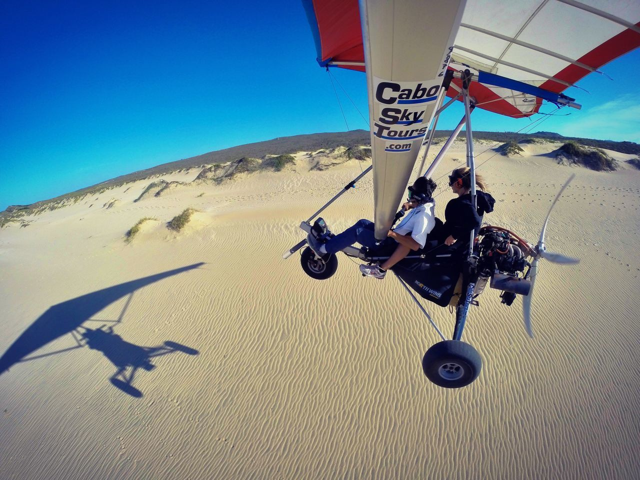Sunlight Shadow Sand Real People Two People Extreme Sports Outdoors Transportation Day Adventure Arid Climate Vacations Desert Nature Landscape Togetherness Sky Travel Determination Adrenaline Adrenaline Junkie Fly Away Skydiving Scenics LosCabos