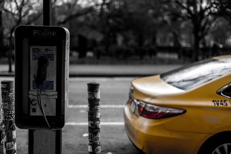 Payphone Taxi Public Public Places New York Transportation Car Focus On Foreground Day No People Yellow Yellow Taxi Communication Transportation