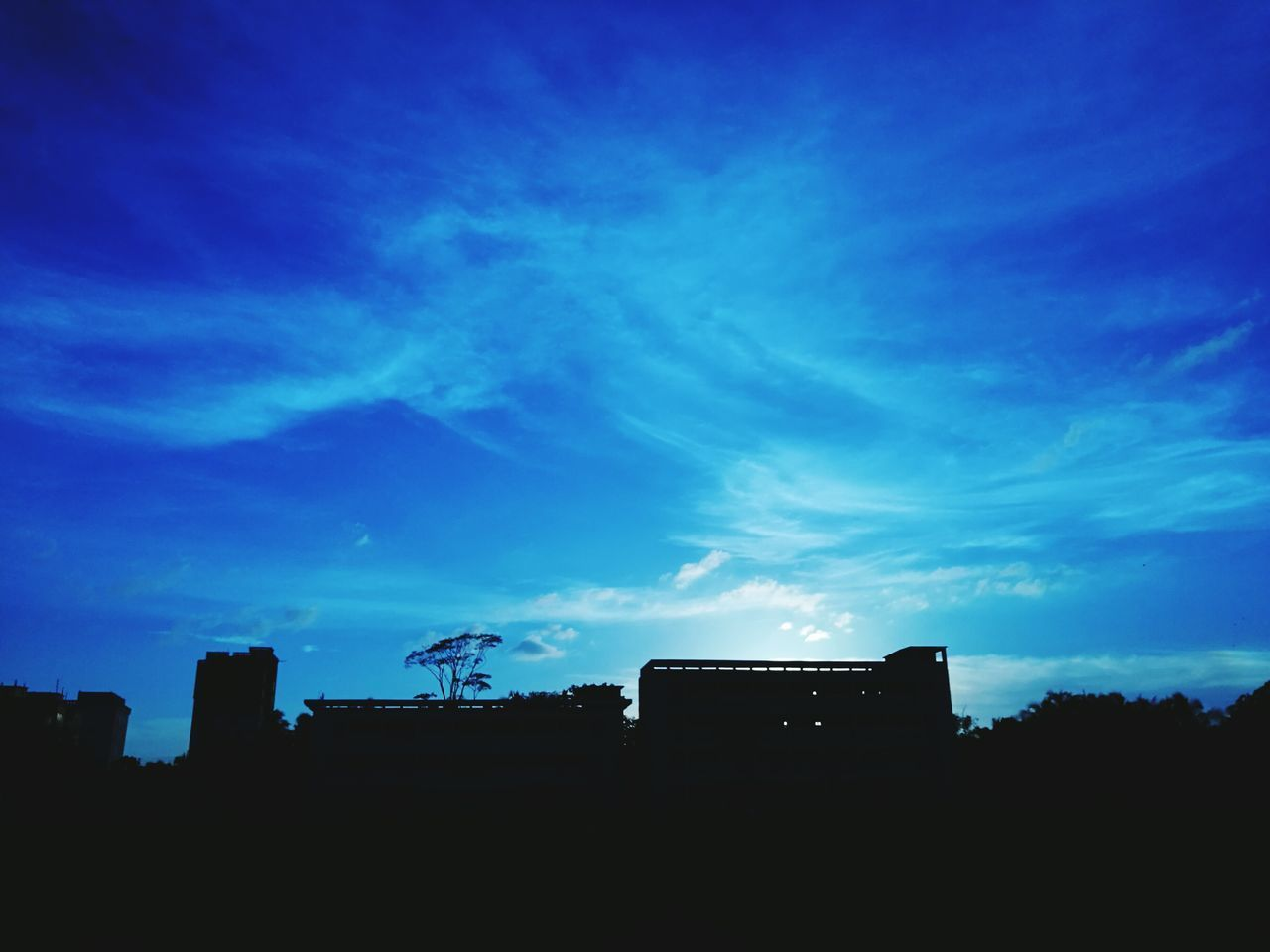 silhouette, architecture, built structure, low angle view, sky, building exterior, blue, outdoors, no people, sunset, nature, day