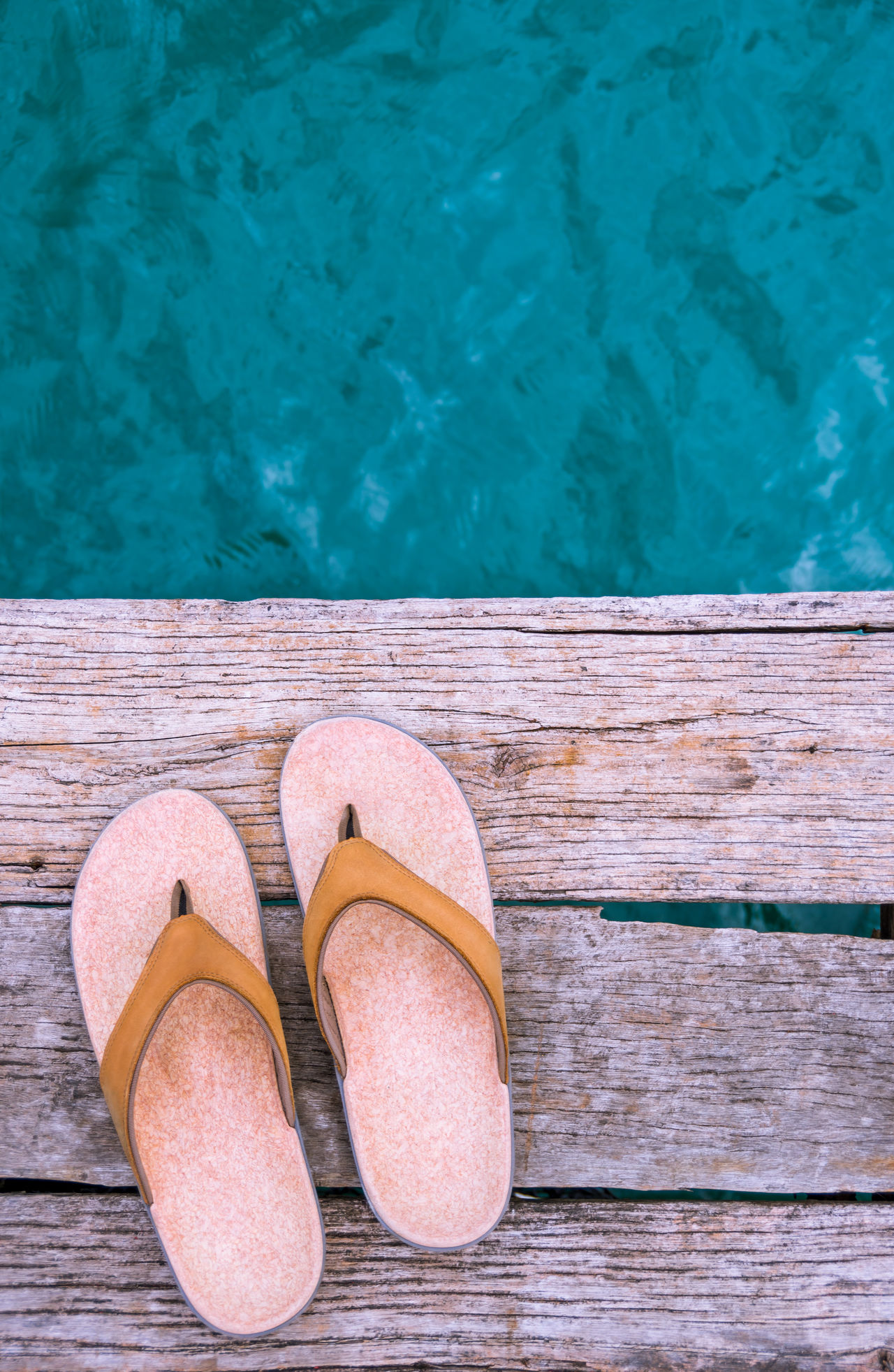 Pair of beige sandals on edge of wooden dock above turquoise water in Thailand. Adventure Aqua Beige Destination Dock Flip Flops Flip-flop Flipflops High Angle View Outdoors Pair Paradise Sandals Summer Summer Vibes Summertime Swim Swimming Tan Tropical Turquoise Vacation Time Vacations Water Wood