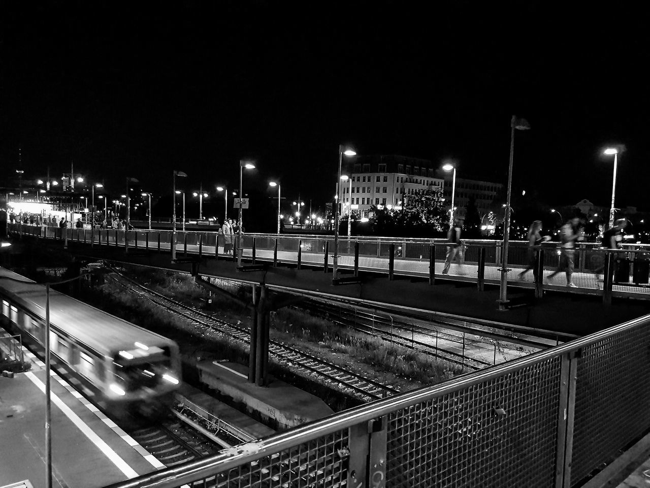 night, illuminated, transportation, rail transportation, railroad track, outdoors, built structure, architecture, clear sky, building exterior, no people, city, sky