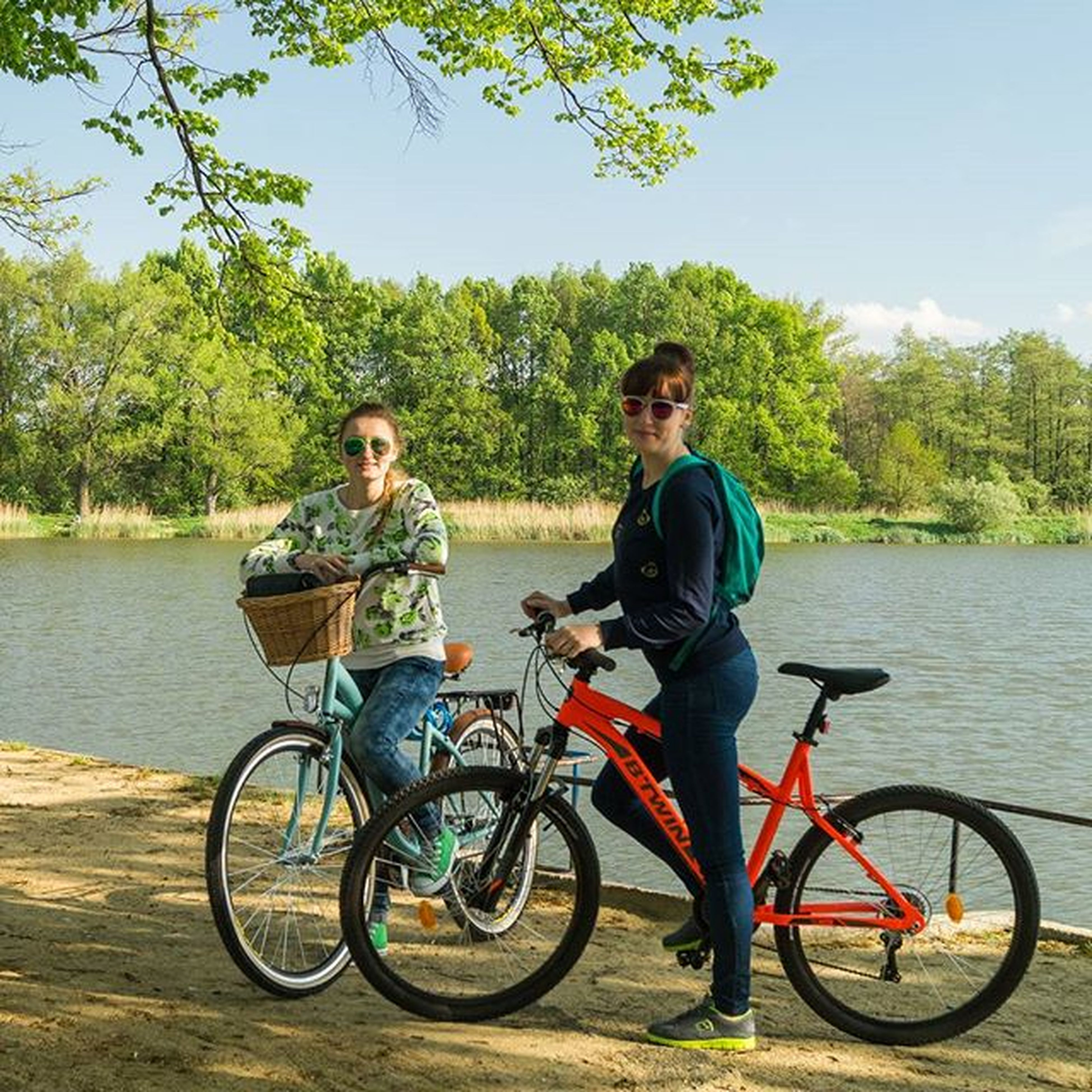 bicycle, mode of transport, transportation, lifestyles, leisure activity, water, tree, river, lake, riding, land vehicle, casual clothing, men, full length, sitting, travel, nature, day