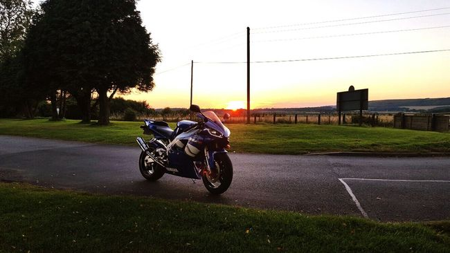 Motorcycle Outdoors Sunset Leisure Activity Riding Fun Yammaha Blue Grass Beauty In Nature Residential Area