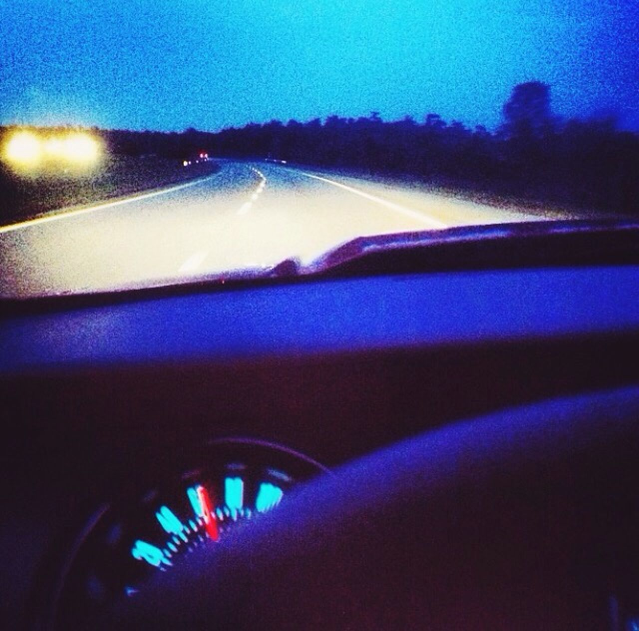 vehicle interior, transportation, car interior, car, mode of transport, land vehicle, windshield, travel, dashboard, illuminated, car point of view, journey, no people, the way forward, night, close-up, road trip, speedometer, sky
