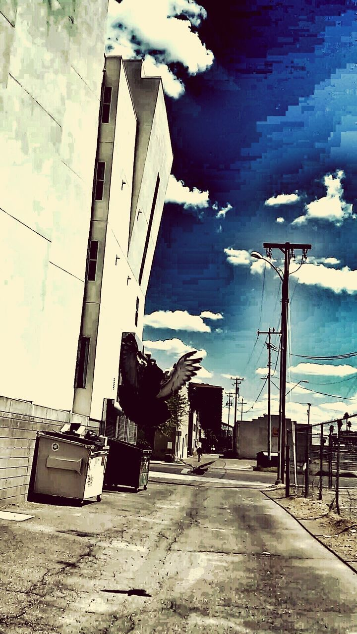 sky, built structure, building exterior, architecture, outdoors, cloud - sky, day, real people, one person, city, people