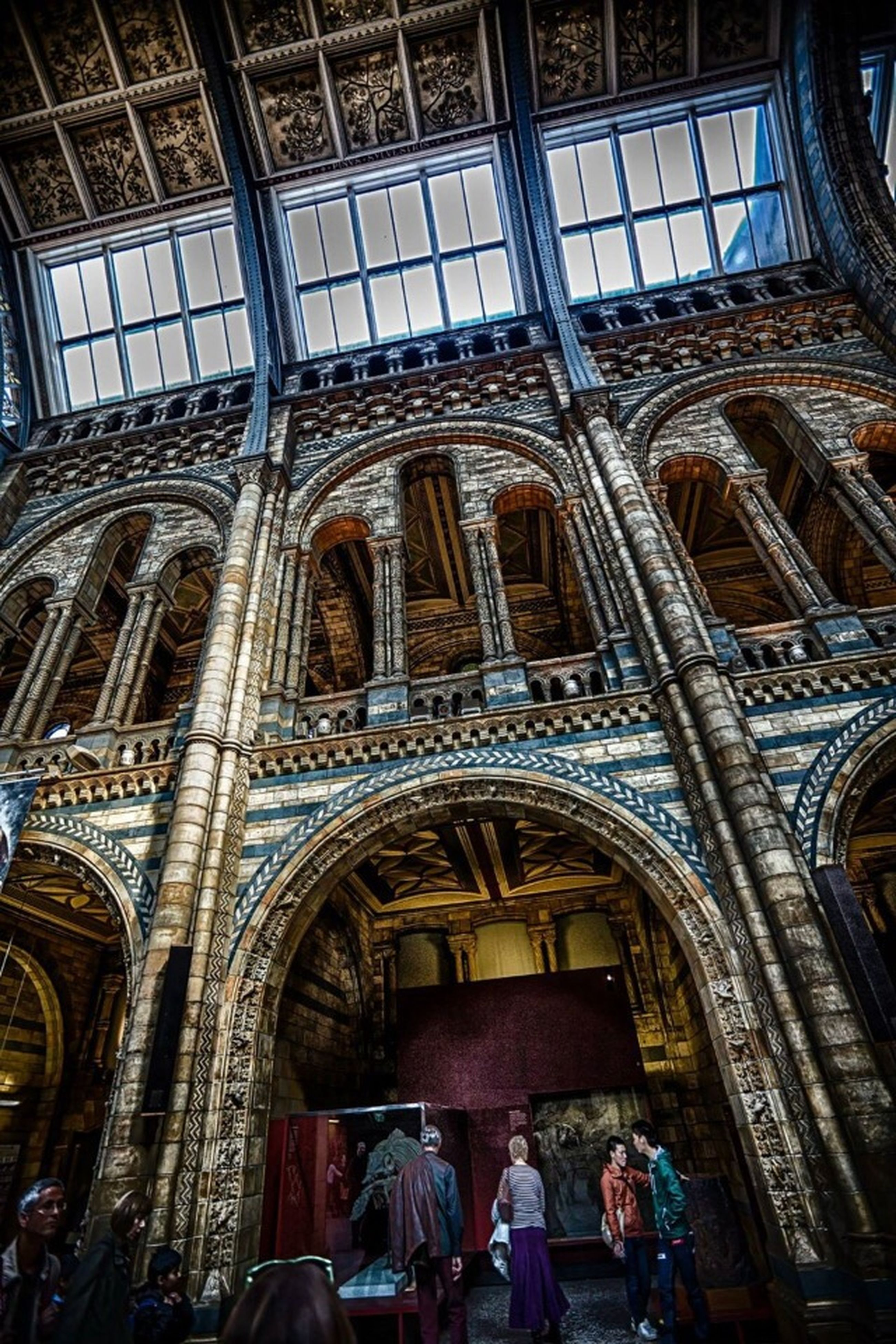 architecture, indoors, built structure, arch, men, large group of people, travel, lifestyles, person, famous place, travel destinations, tourism, leisure activity, history, ceiling, tourist, interior, low angle view, international landmark