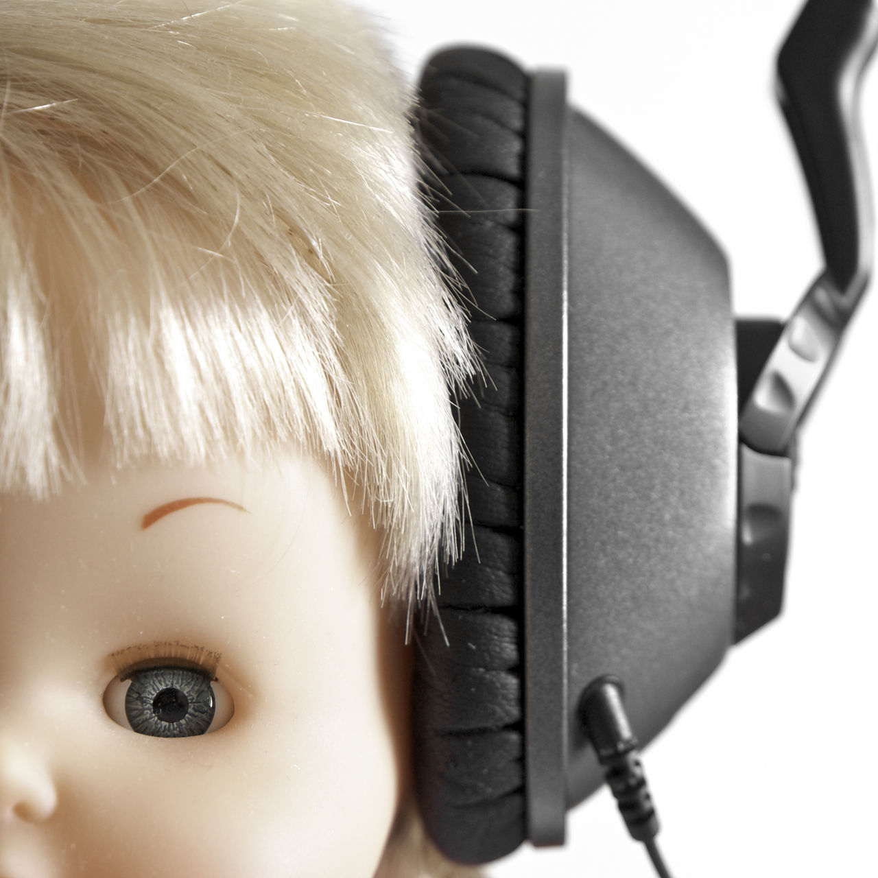 Doll wearing headphones Childhood Close-up Composition Cute Doll Front View Headphones Innocence Listening Music Looking At Camera Music Part Of Perspective Portrait Relaxation Serious Sitting Toy Young Adult Young Women