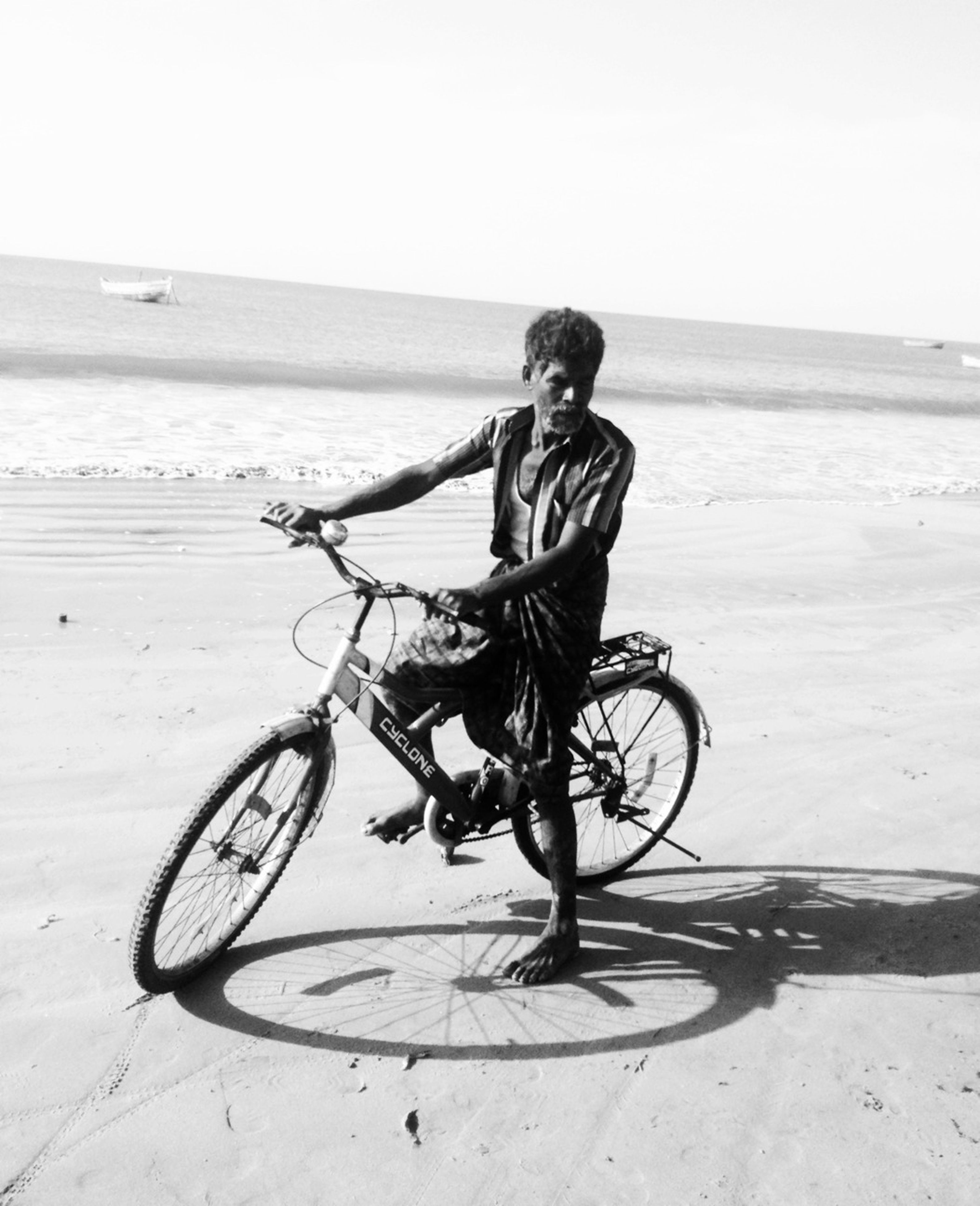 bicycle, mode of transport, transportation, full length, land vehicle, beach, leisure activity, riding, side view, sand, lifestyles, stationary, childhood, casual clothing, day, parking, shore, sea