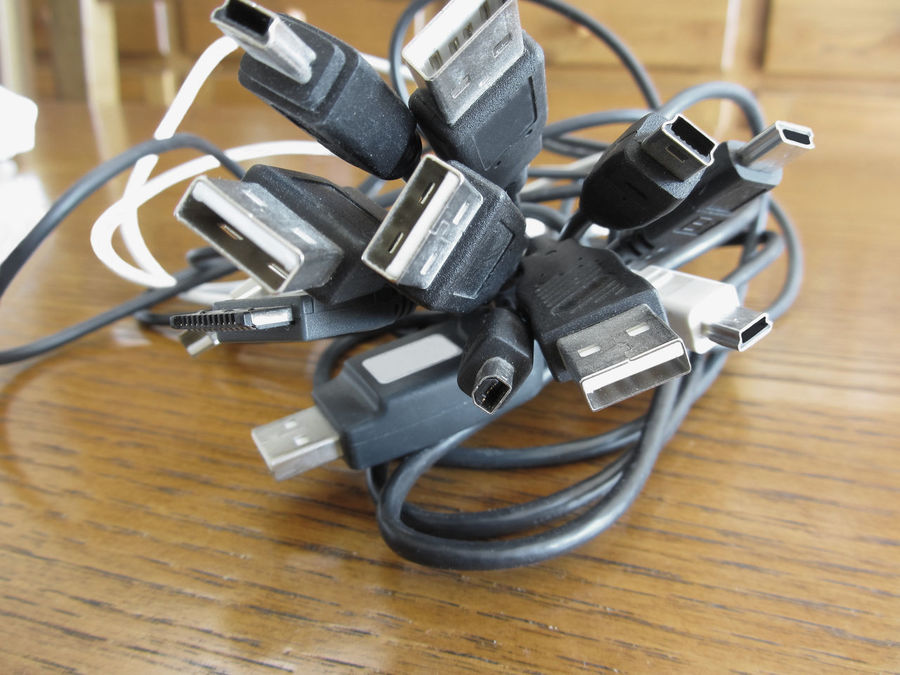 Tangle of dusty computer cables with sockets on the table Appliance Bunch Cable Charge Computer Connection Connector Cord Device Dusty Equipment Internet LINE Many Mess Outlet PC Plug Power Socket Table Tangle Technology USB Wires