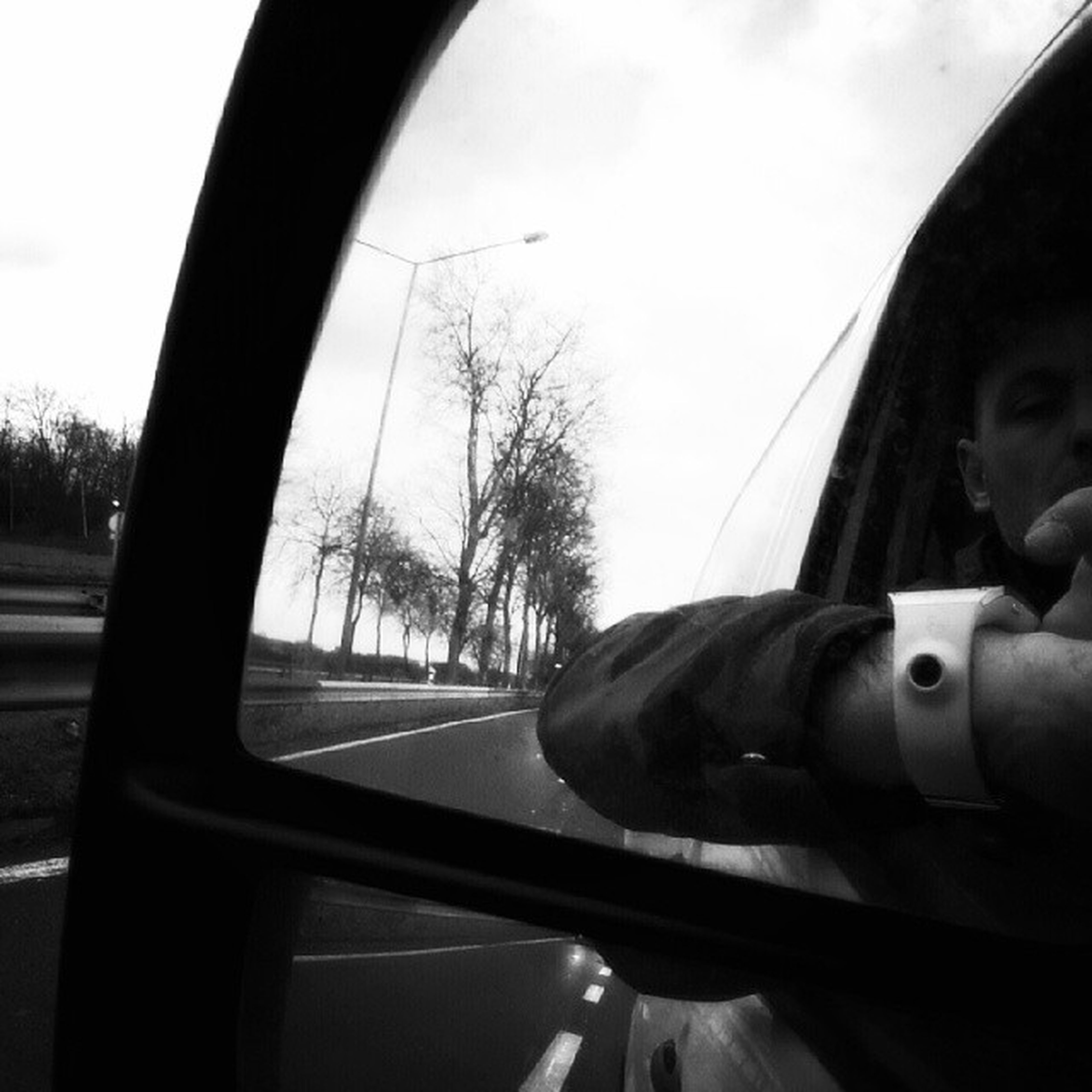 transportation, mode of transport, vehicle interior, car, land vehicle, car interior, glass - material, travel, transparent, windshield, side-view mirror, sky, window, part of, journey, tree, public transportation, cropped
