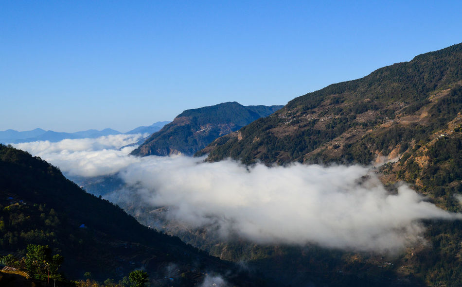 Annapurna Mountain Range Beauty In Nature Clouds And Sky Cold Mountain Colors Extreme Weather Foggy Mountain Town Mountain Nature Sea Of clouds Snow Covered Landscape Snowcapped Mountain Travel Travel Photography Traveling Trekking In Nepal Winter