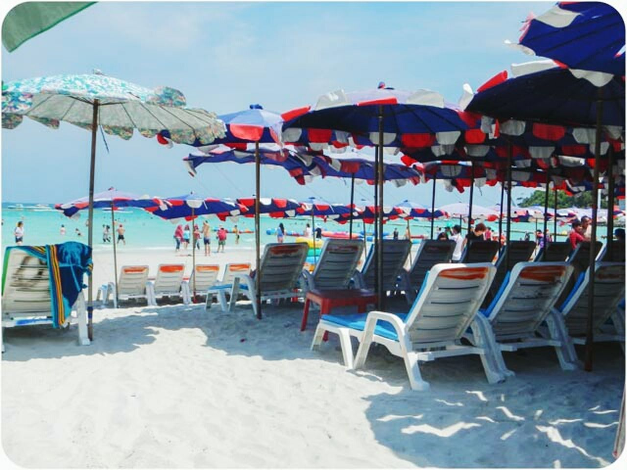 beach, chair, sand, fun, vacations, sea, summer, relaxation, outdoor chair, table, bar - drink establishment, group of objects, day, travel destinations, outdoors, nature, party - social event, no people, sky