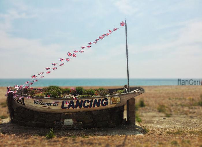 Beach Boat Depth Of Field Flag Lancing  Sea Selective Focus Sky Uk United Kingdom