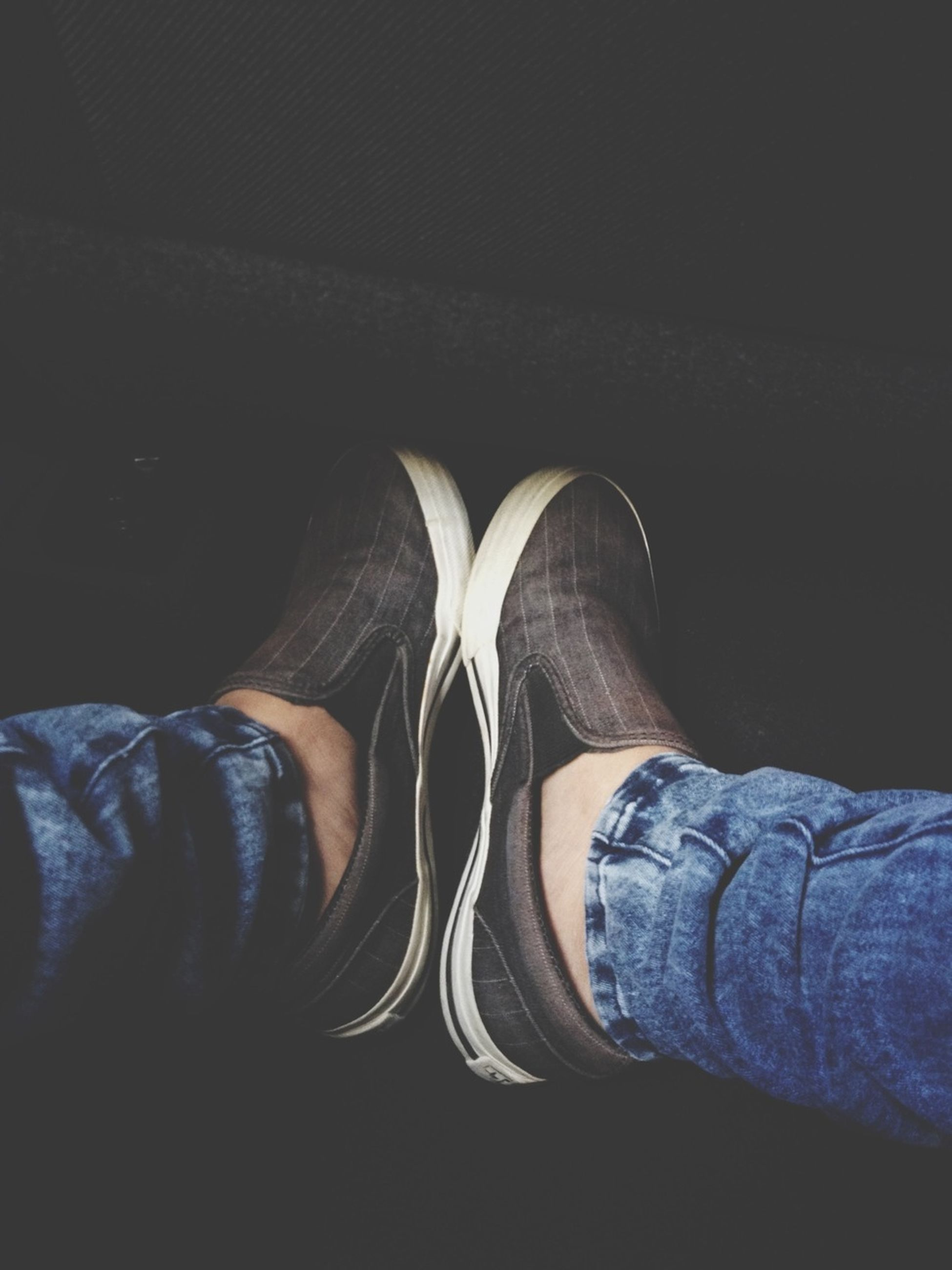 low section, person, shoe, indoors, jeans, lifestyles, men, personal perspective, standing, footwear, casual clothing, leisure activity, human foot, sitting, relaxation, unrecognizable person