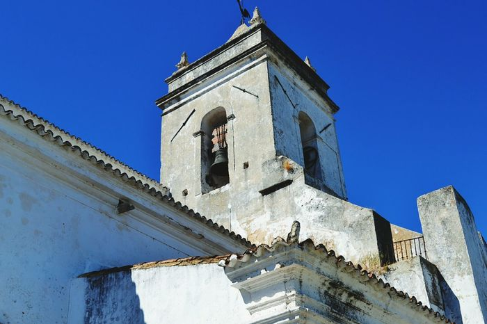 Outspoken cicada Place Of Worship Low Angle View Architecture Outdoors Tower No People Building Exterior Travel Destinations Sky Bell Clear Sky Bell Tower - Tower Pilgrimage Church Algarve Portugal_lovers Holiday Tavira, Portugal Tavira Algarve Portugal Algarve, Portugal