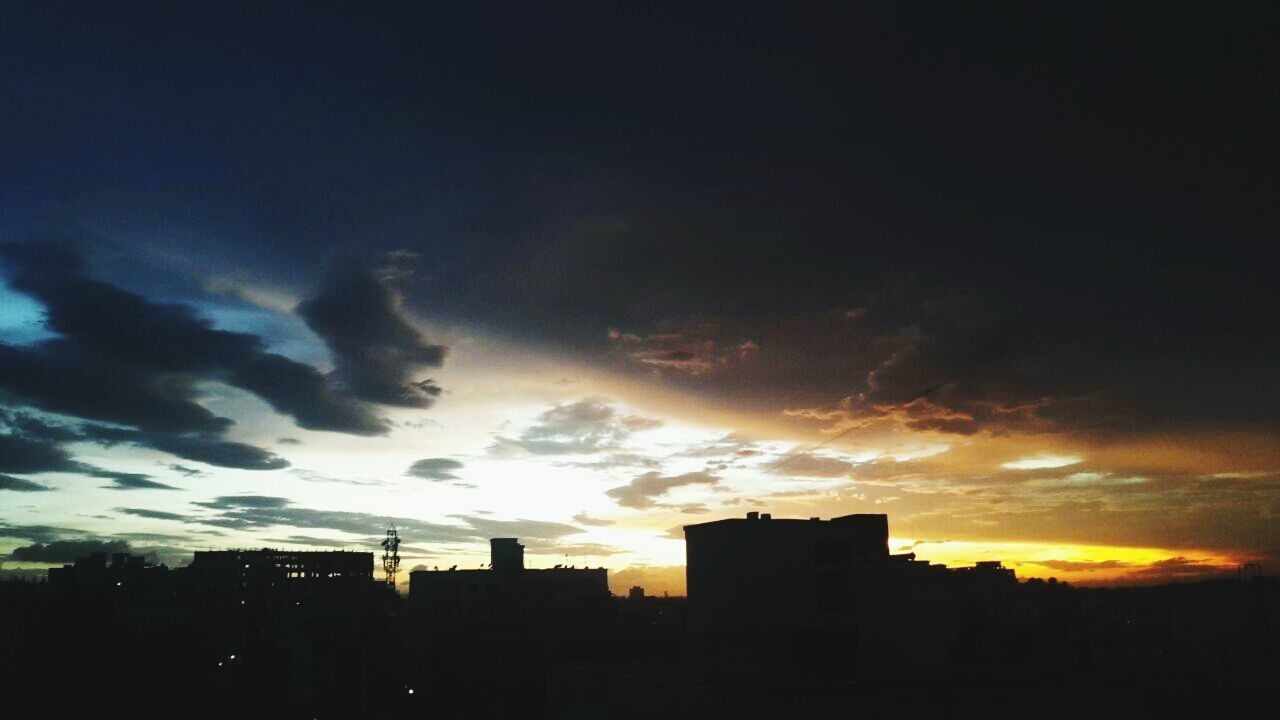 sunset, silhouette, architecture, city, building exterior, cityscape, sky, skyscraper, no people, built structure, modern, outdoors, nature
