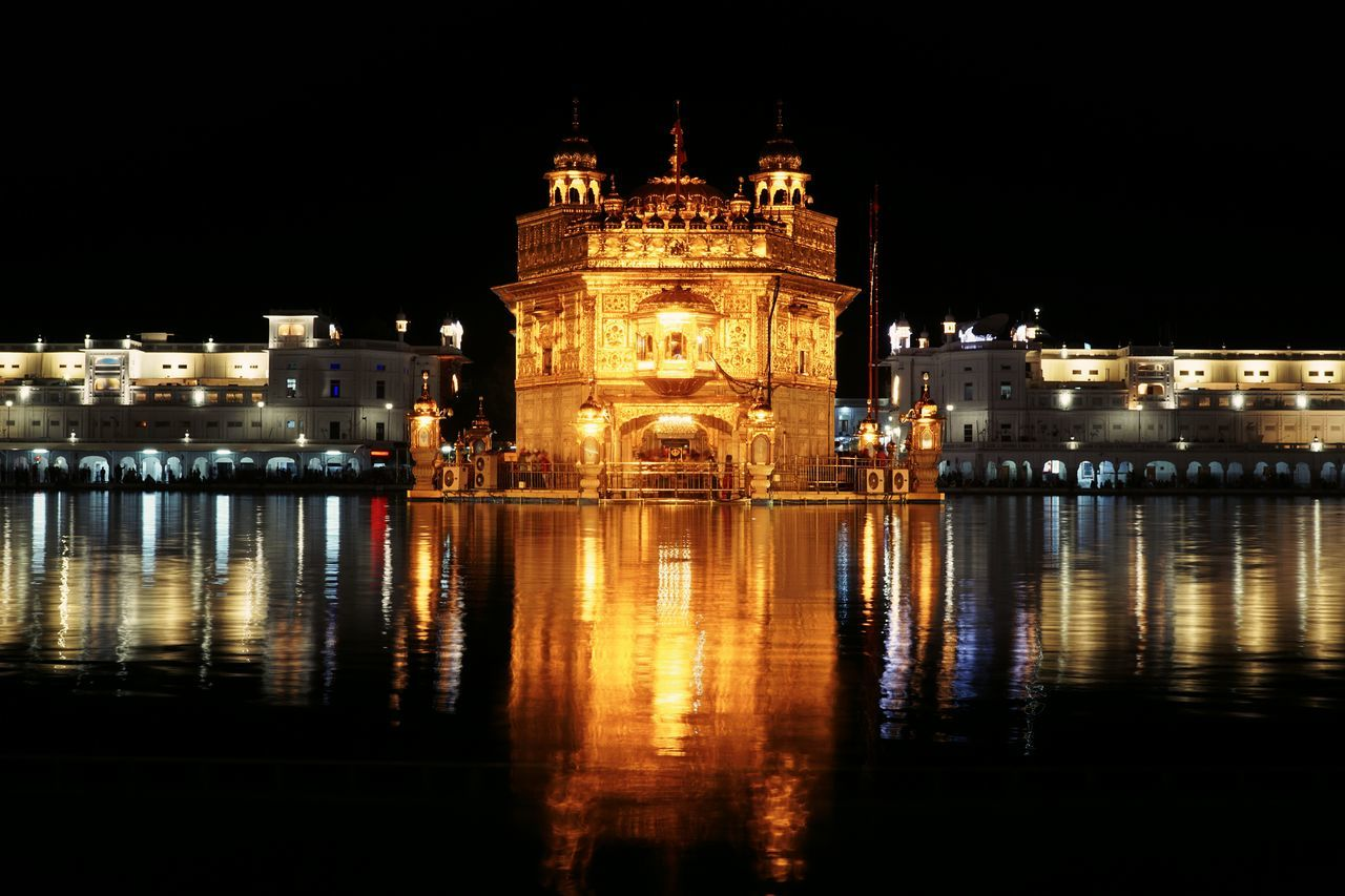 Golden temple, amritsar Reflection Night Architecture Travel Destinations Illuminated Water Symmetry Travel Built Structure No People Scenics Outdoors Building Exterior History
