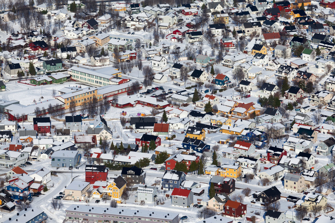 A closer look of the aerial view of the city of Tromso from the hill, a city in northern Norway, also a major cultural hub above the Arctic Circle. Aerial View Architecture Backgrounds Building Exterior City Cityscape Colourful Hill View Hub Outdoors Red White Yellow