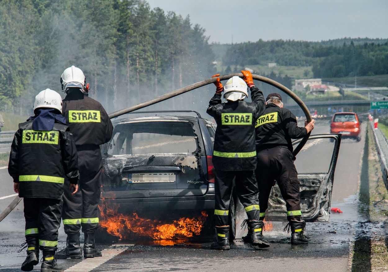 Burning Car Road Accident Car Day Extinguishing Car Fire Firefighters Firefighters In Action Men Outdoors People Road Accident EyeEmNewHere