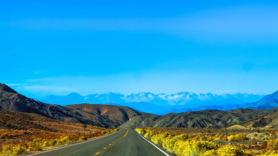 Beauty In Nature Blue Day Landscape Mountain Mountain Range Mountain Road Nature No People Outdoors Road Scenics Sky The Way Forward Tranquil Scene Tranquility Transportation Winding Road