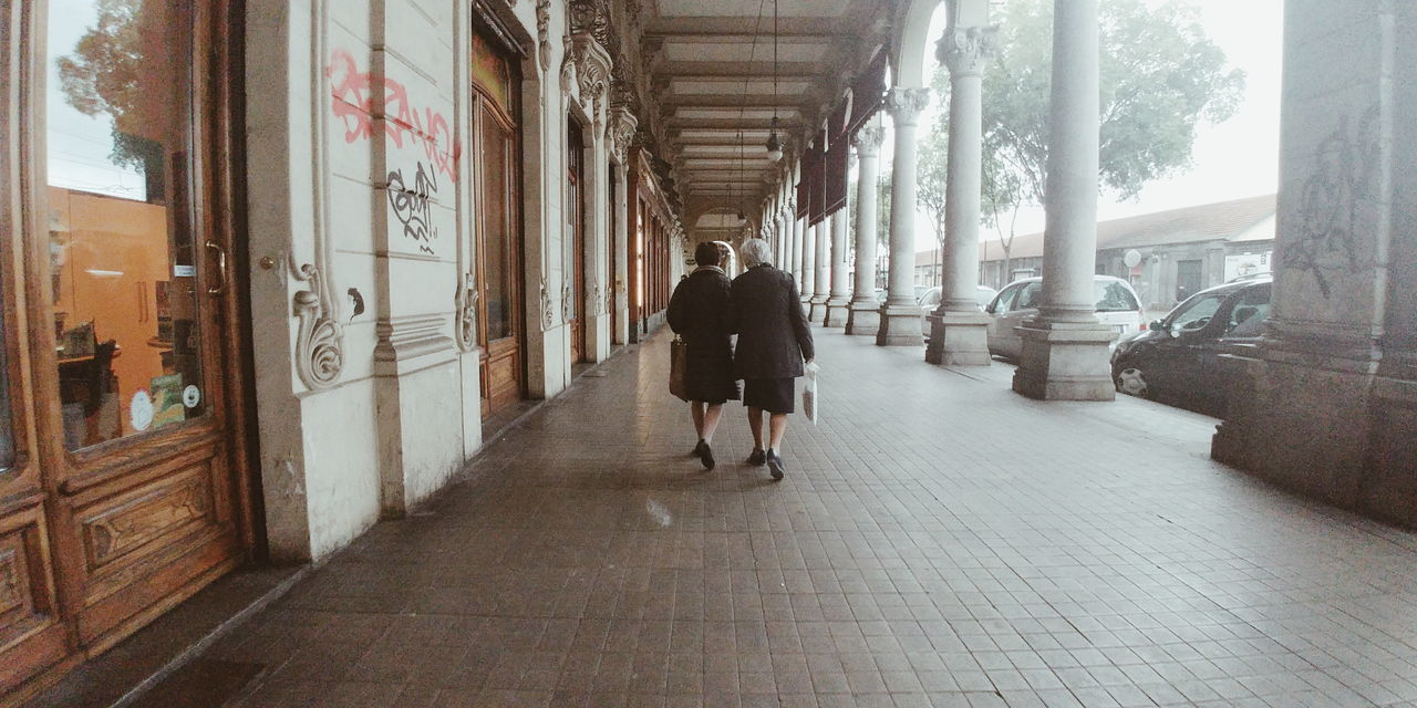 Friendship never ends Rear View Friendship Woman Full Length Streetphotography The Way Forward People Day Architecture Politics And Government
