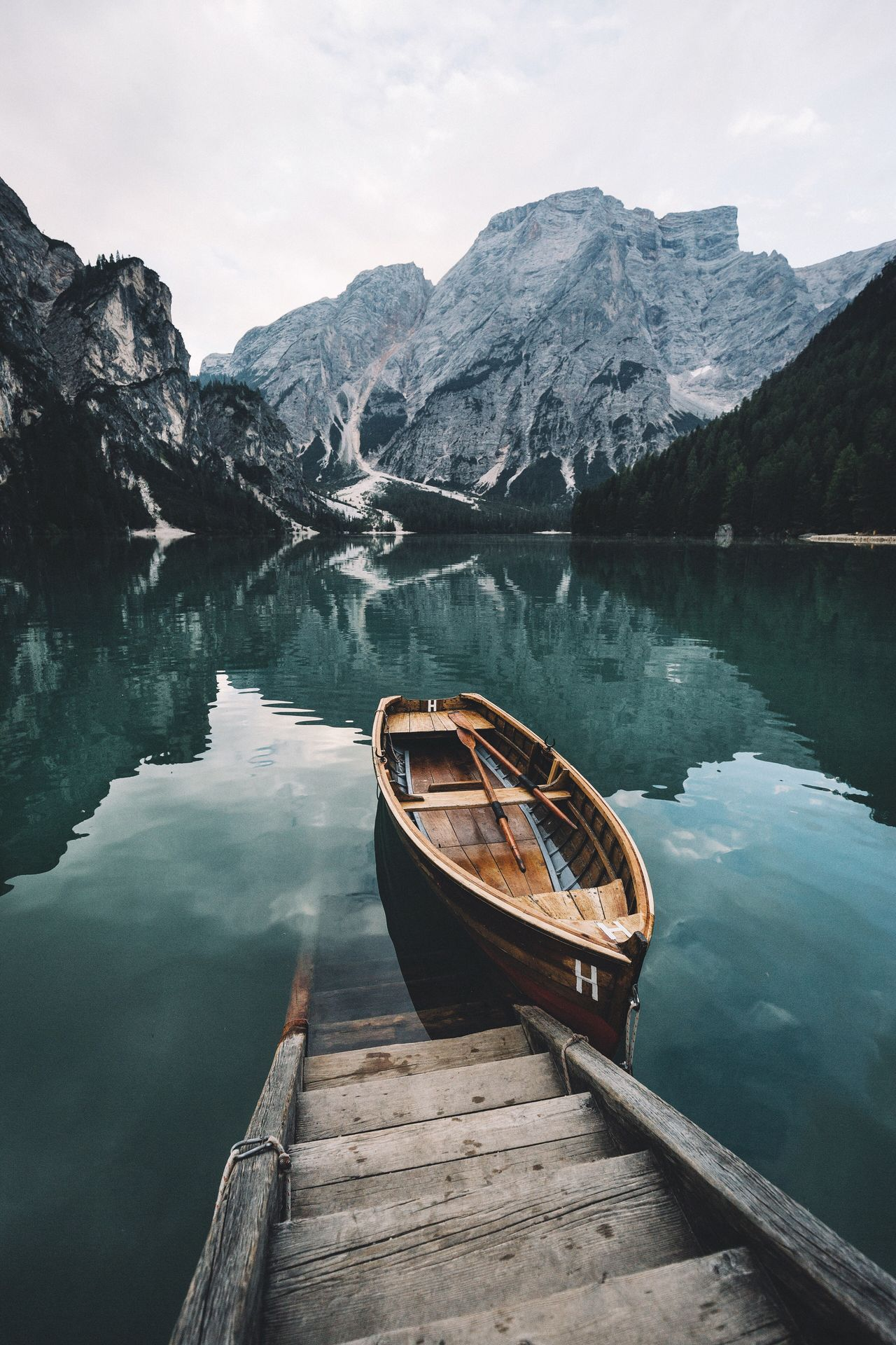 Explore more. Travel Itay Dolomites, Italy Outdoors Mountain Water Scenics Reflection Beauty In Nature Lake Nautical Vessel Nature Transportation Mode Of Transport Mountain Range Tranquility No People Day Sky