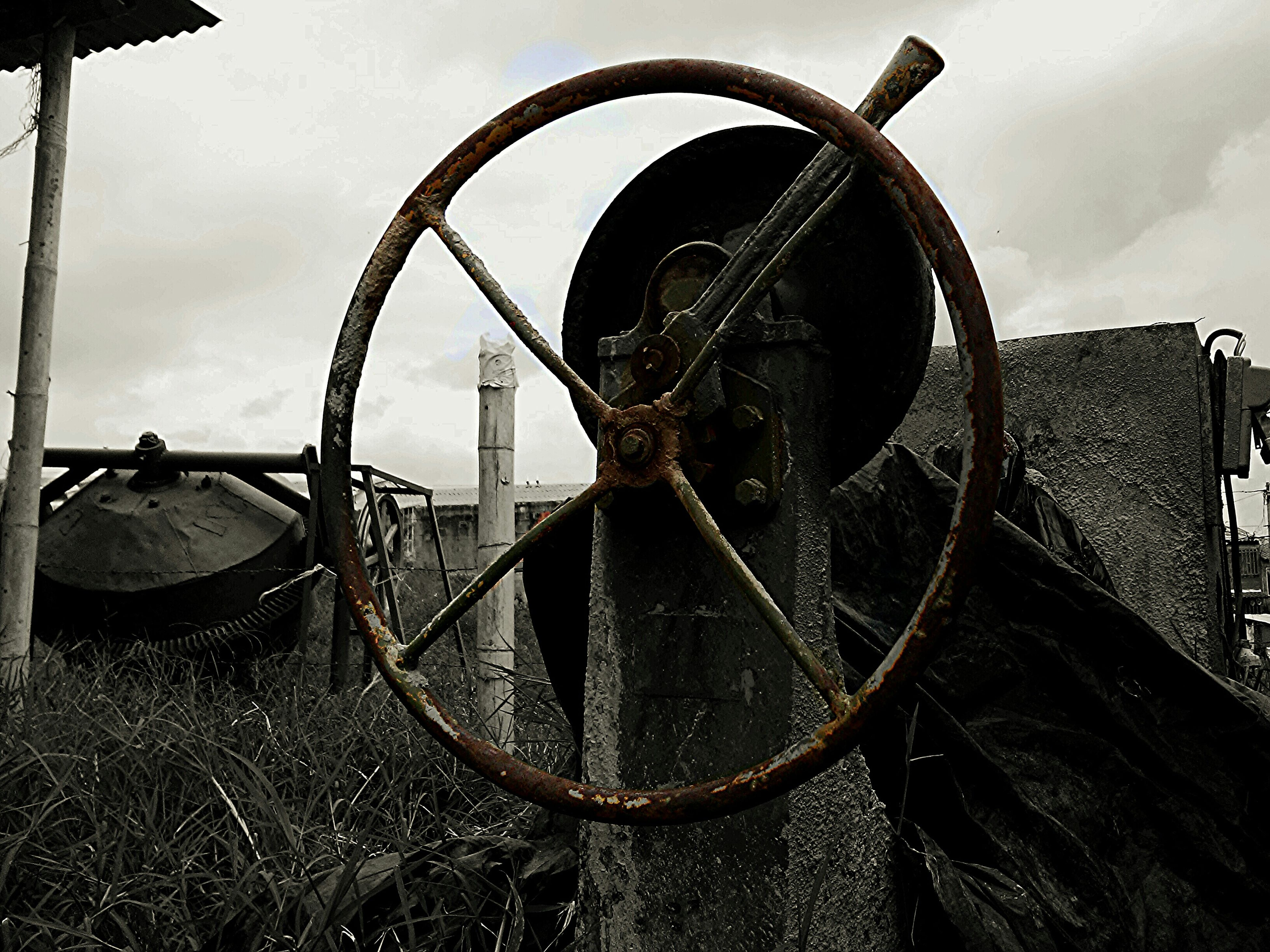 sky, metal, rusty, building exterior, cloud - sky, built structure, architecture, old, day, safety, abandoned, protection, outdoors, transportation, obsolete, security, damaged, old-fashioned, wheel, metallic