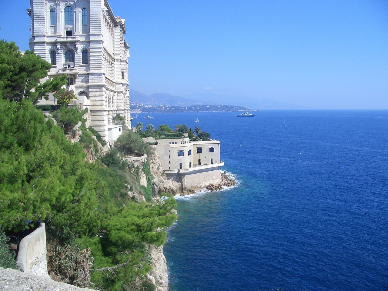 architecture, sea, built structure, building exterior, water, nature, day, outdoors, history, no people, scenics, beauty in nature, sky, travel destinations, cliff, tree, horizon over water, clear sky