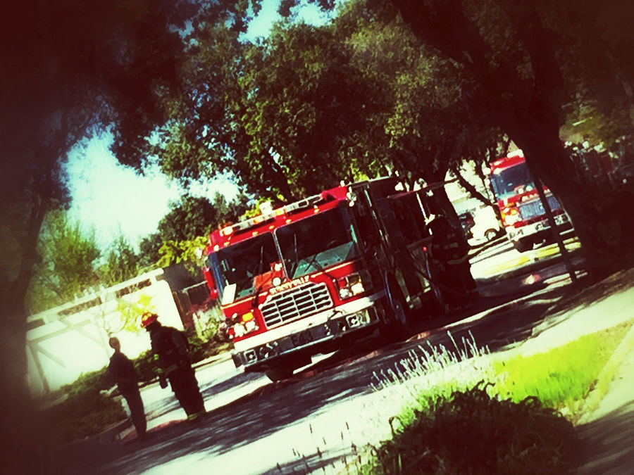 Firetrucks on residential street Danger Editorial  Emergency Vehicles Filtered Image Fireman Firetrucks Houses Outdoors People Phone Camera Response Security Shadows Street Suburbia Suburbs Transportation Trees