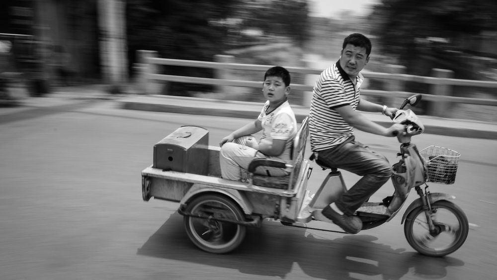 stare at the european tourist: 2 Black And White Bnw Children China City Drive Electric Car EyeEm Best Shots Fortheloveofblackandwhite Kids Life Looking At Me Monochrome Motorcycles Moving People Portrait Shootermag Showcase: February Side View Speed The Tourist Transport Transportation capturing motion Let's Go. Together. Connected By Travel