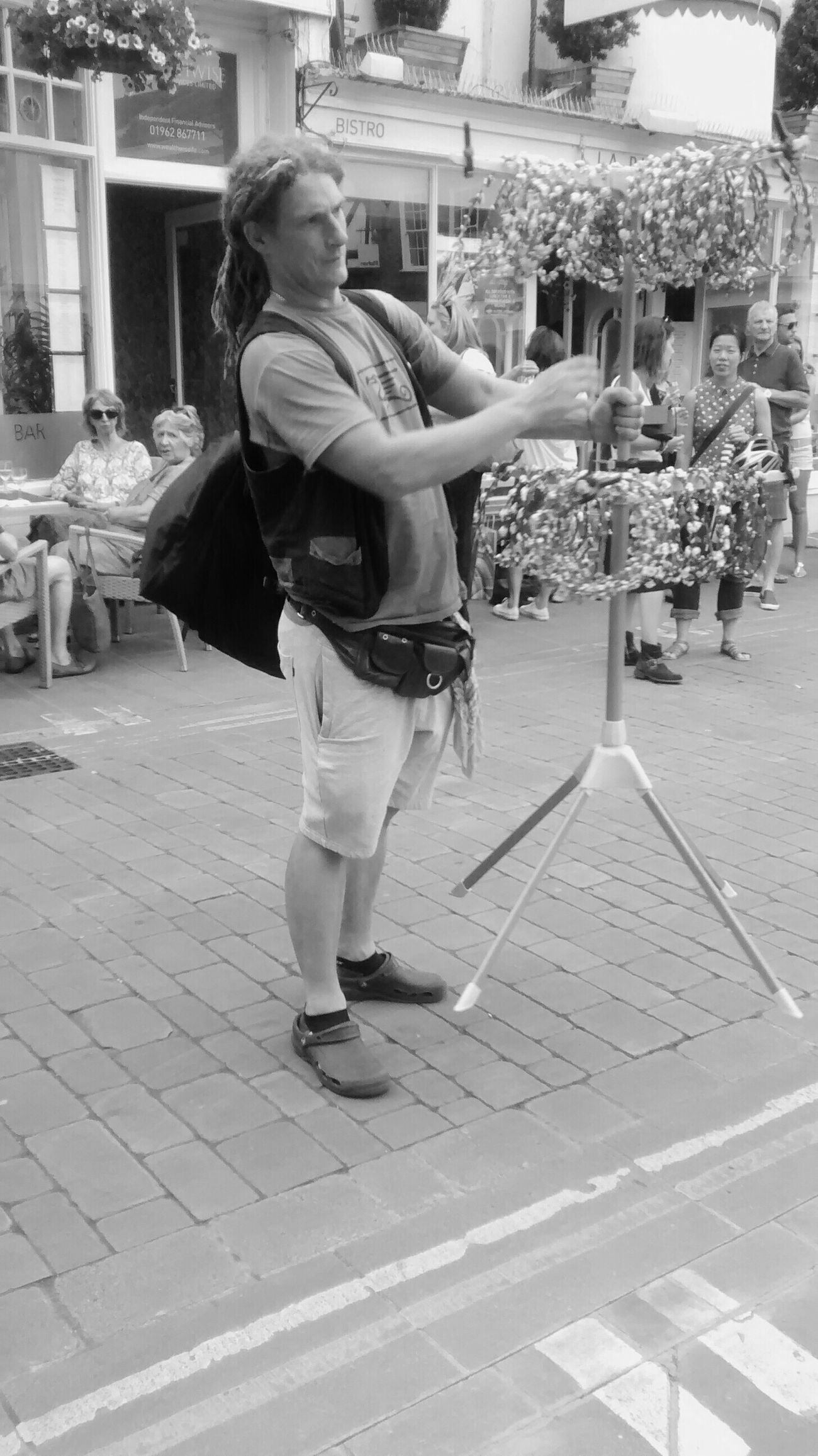 The puzzle of the floating tripod !! Blackandwhite Photography Streetphotography People Watching Hat Fair