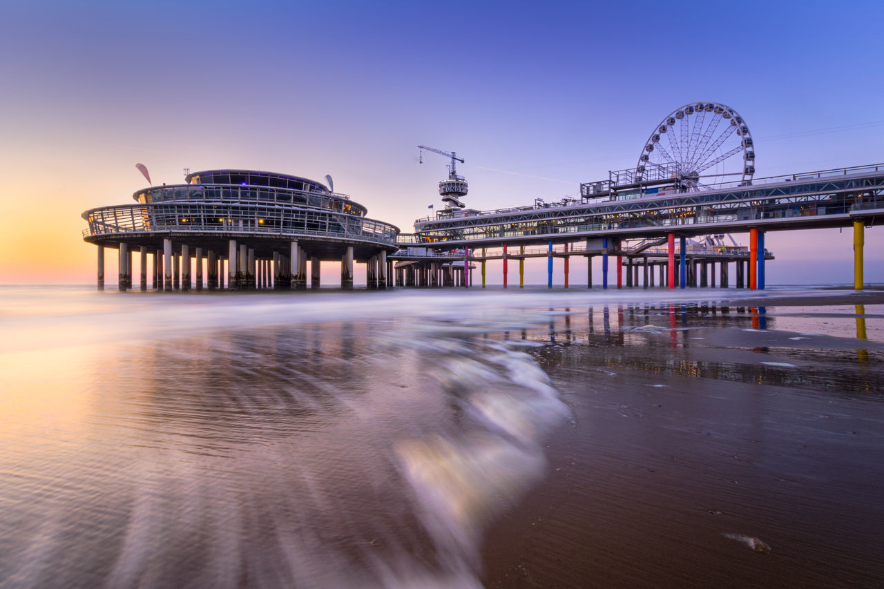 The famous landmark The Pier in Scheveningen as seen from the left side. Architecture Beach Built Structure Day Landmark Netherlands No People Outdoors Pier Sand Scheveningen  Scheveningen Pier Shore Sky Sunset The Hague Travel Water