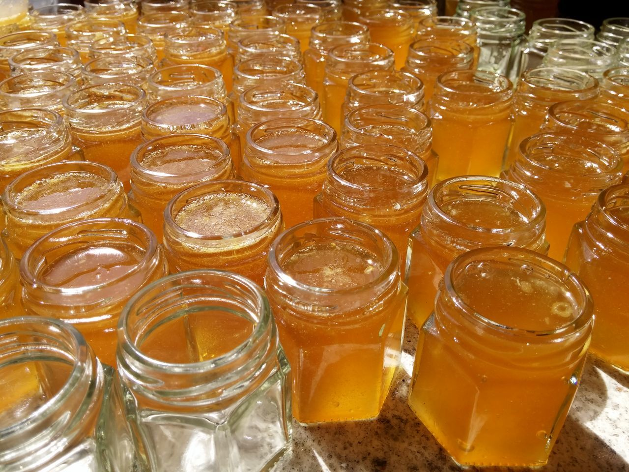 Tedium. Food And Drink Freshness Close-up Indoors  Honey Jars  Work Miele 45g jars filled with raw honey.
