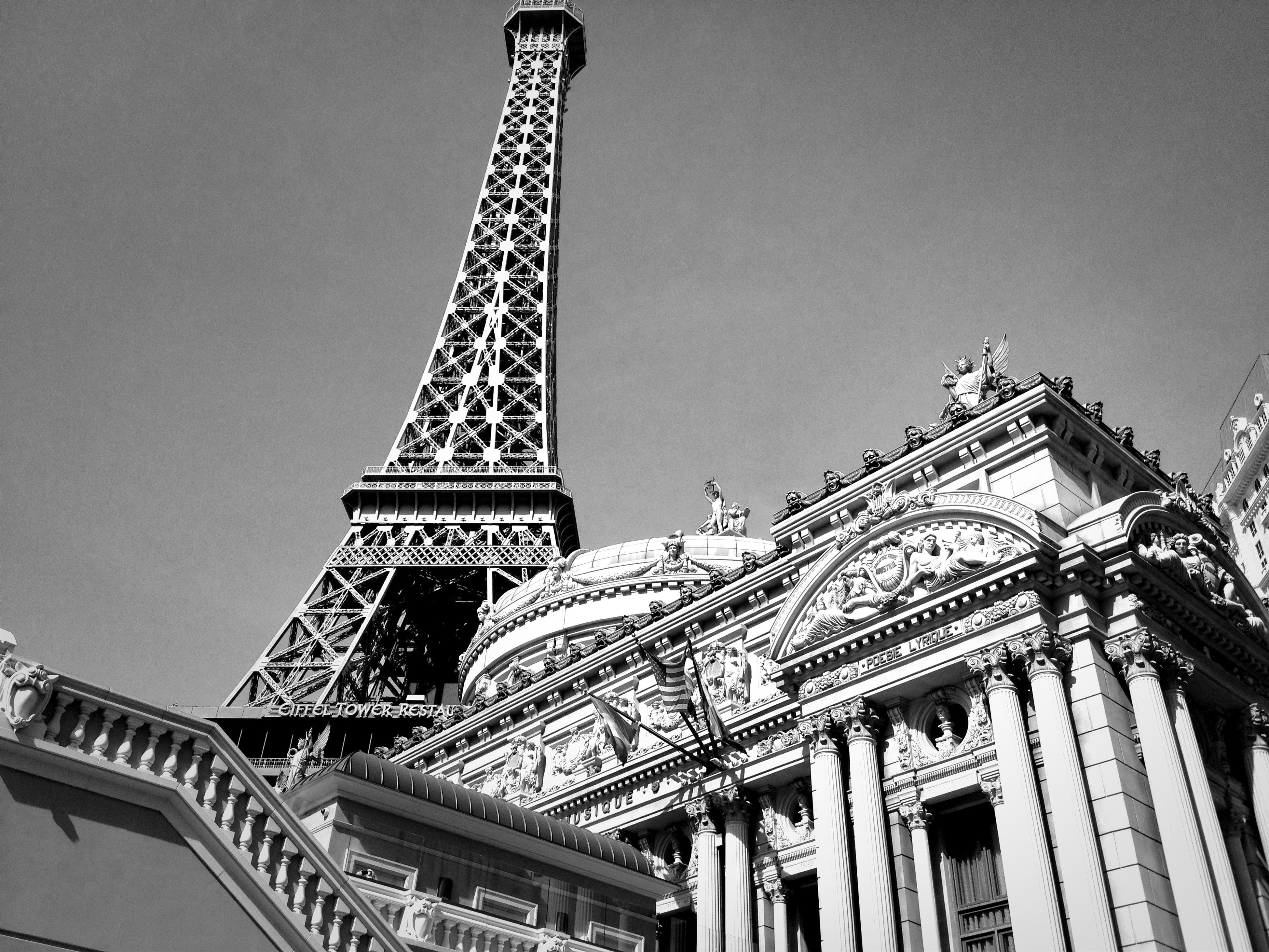 low angle view, architecture, built structure, famous place, clear sky, building exterior, travel destinations, international landmark, history, tourism, travel, capital cities, architectural feature, religion, art and craft, place of worship, tower, culture, art, eiffel tower