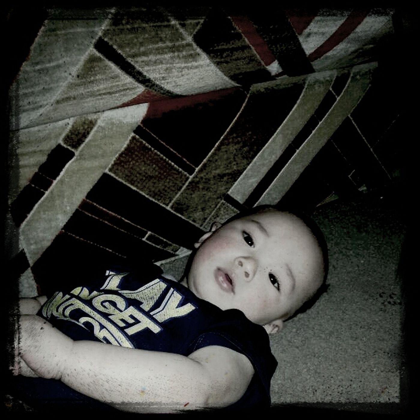 Relaxingmy nephew. Love this little devil.
