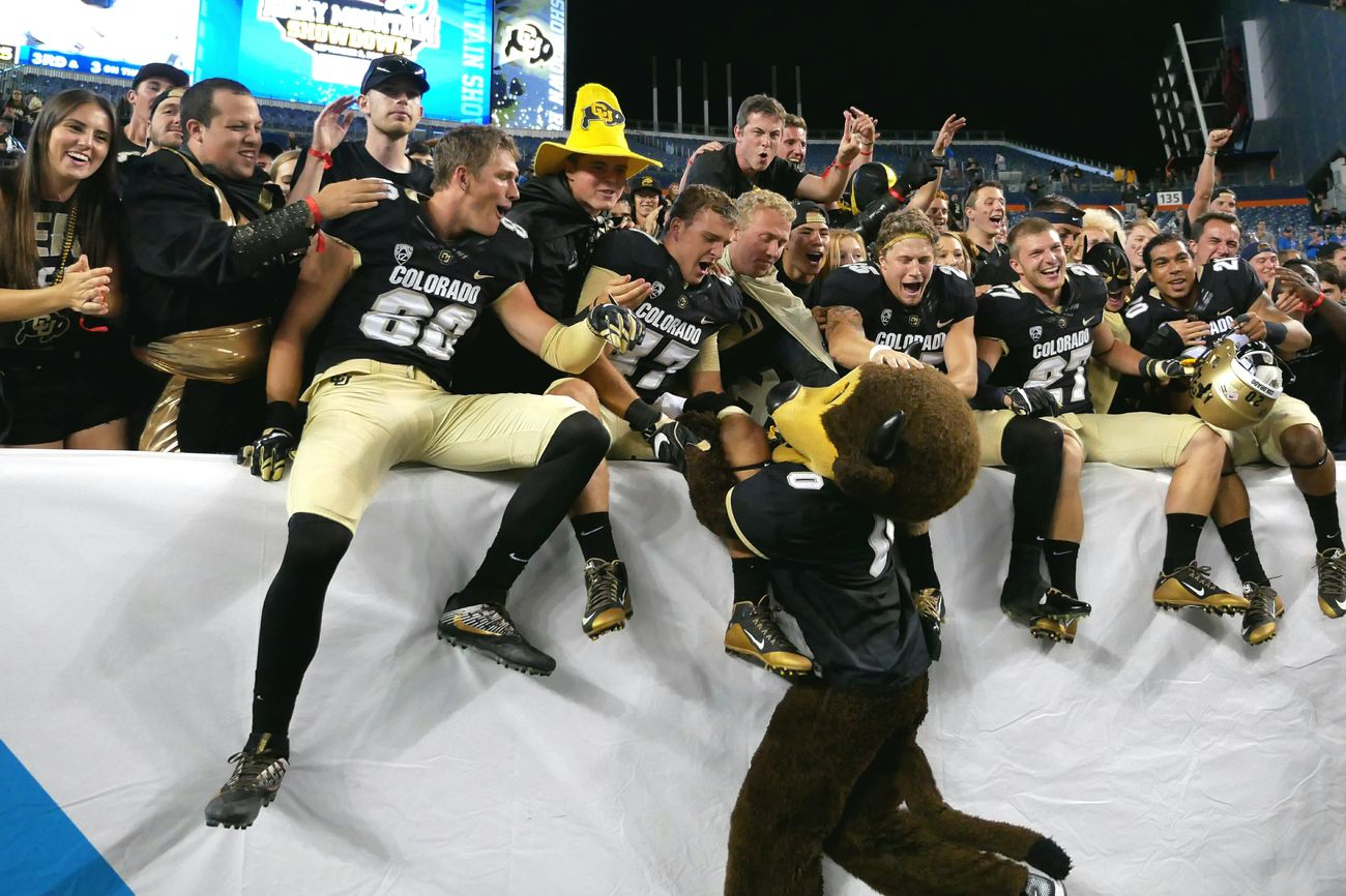 Football players join the fans after winning against an interstate rival. Large Group Of People Men Standing Person Lifestyles Celebration Leisure Activity Casual Clothing Togetherness Culture Crowd Mask - Disguise Outdoors Person Famous Place University Of Colorado Boulder Spectator College Football Tradition Athletics Sports