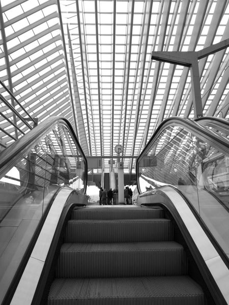 Escalator Technology Indoors  Low Angle View People Watching People Train Station. Architecture Modern Black And White