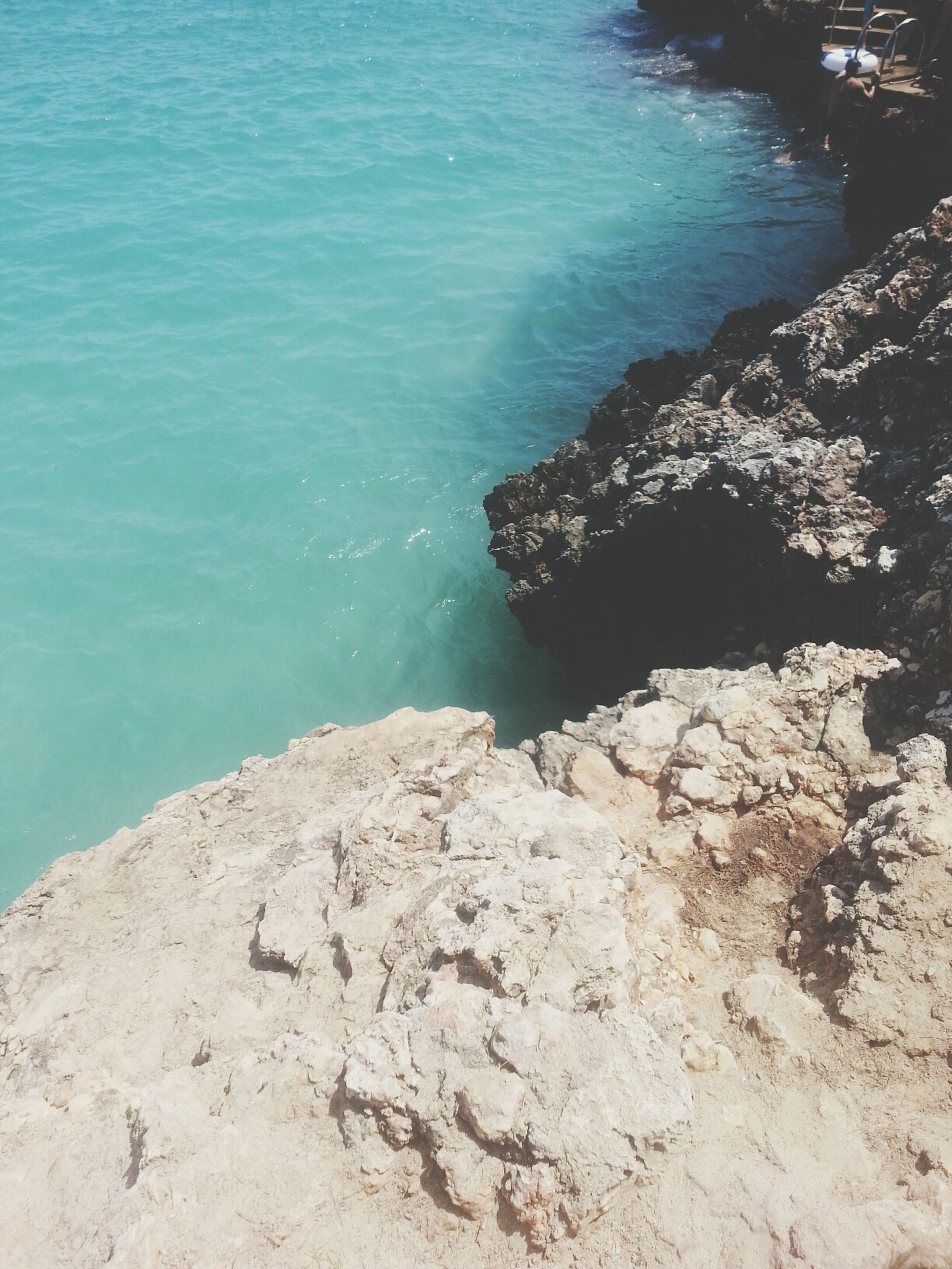 water, sea, rock - object, tranquility, high angle view, nature, rock formation, tranquil scene, beauty in nature, scenics, blue, shore, beach, day, rock, sunlight, outdoors, idyllic, cliff, no people